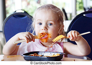 Little girl covered in tomato sauce - Cute little blond girl...