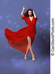 windblown - Fashion shot of the elegant woman in beautiful...