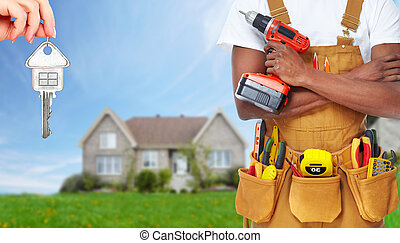 Builder handyman with construction tools House renovation...