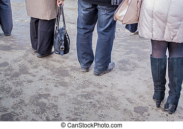 People Waiting for A Bus - The different legs of people...