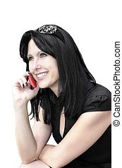 Smiling woman with a phone on a white background