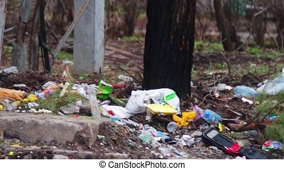 Trash on the street - A lot of garbage, which lies on the...