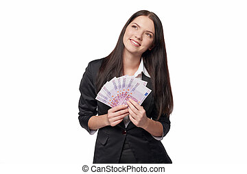 Dreamy woman holding euro money - Dreamy business woman...