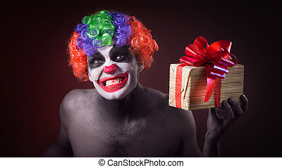 scary clown makeup and with a terrible gift in hand in the...
