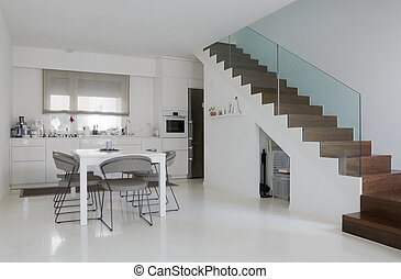 white kitchen and dining room with white epoxy floor and...