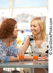 Narration - Two girls in cafe look against each other and...