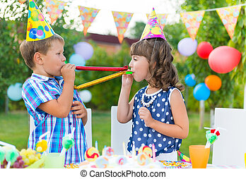 Happy children having fun at birthday party - Two happy...
