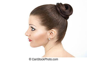 Hairdress - Female profile with a hairdress and a make-up,...