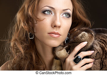 Rich woman - The beautiful woman in furs and jewelry