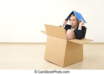Irreparableness - A business woman sits in a box, taking...