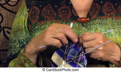 grandma knit with nurse - Hands of old grandma knitting and...