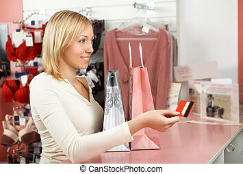 The girl in a boutique - The blonde with packages in an...