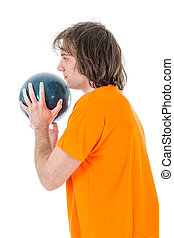 Man is ready to throw a bowling ball, isolated over white