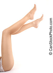 The bared female legs - Female feet are lifted upwards on a...