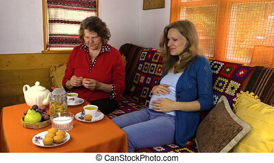 women eat sweets with tea - Senior grandma woman and young...