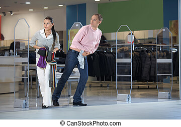 Pilferers in shop - The pair steals clothes from shop and...