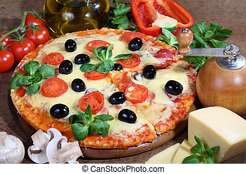 Pizza with cheese, a salami, field mushrooms and olives