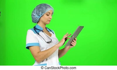 Doctor with stethoscope and a tablet in hands nnabiraet...