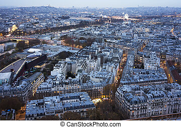 Paris At Sunset With Lights - A cityscape of Paris looking...