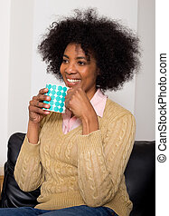 young woman enjoying a coffee at home