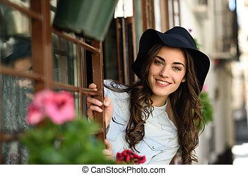 Woman in urban background wearing casual clothes - Portrait...