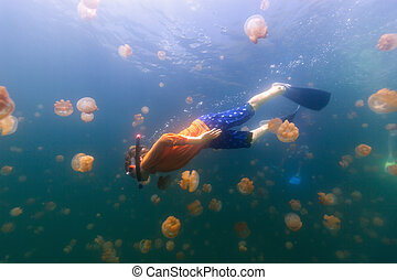 Child snorkeling in Jellyfish Lake