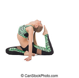 Image of flexible young woman doing gymnastic ring, isolated...