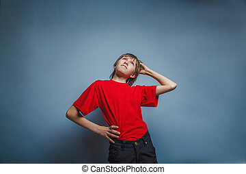Boy, teenager, twelve years in red shirt, thoughtful,...