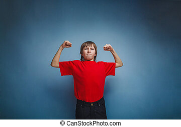 boy, teenager, twelve years in red shirt, showing strength -...