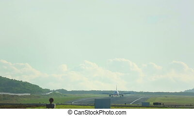 Taxiing - Airplanes taxiing on the runway after landing,...