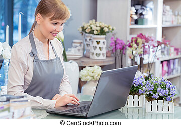 Small business entrepreneur florist in her store - Flower...