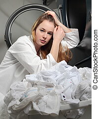 Woman with sad face on  washing machine