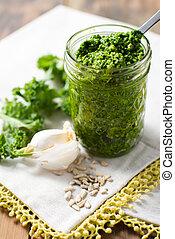 Kale Pesto sauce on white tasting spoon
