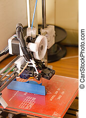 3D Printer side - Side view of a 3D printer after completing...