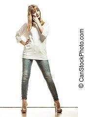 blonde fashion woman in white shirt denim pants - Fashion...