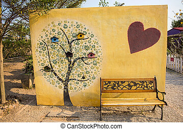 art tree painting on cement wall an