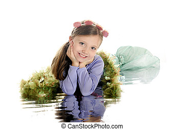 Mermaid Beauty - A beautiful young elementary mermaid laying...