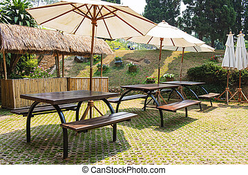 modern wooden bench and umbrella in