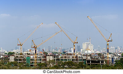 Building and cranes under construction