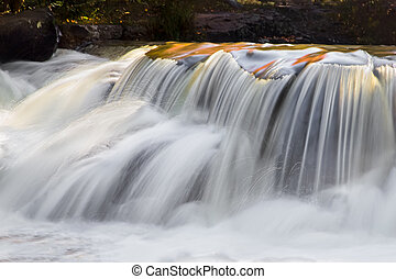 Splashing - Whitewater, photographed with a long exposure,...
