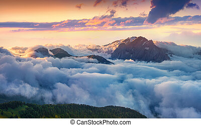 Panorama of the sunrise in foggy Val di Fassa valley -...