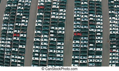 Flying Above Storage Parking Lot of New Unsold Cars, aerial...