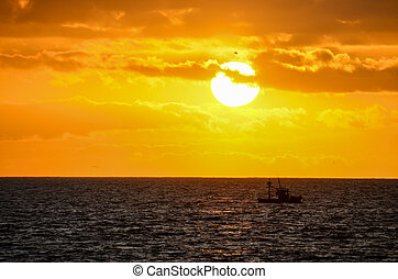 Tropical Sunset - Sun Setting on the Atlantic Ocean in...