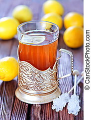 fresh tea with lemon in cup and on a table