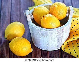 lemons - fresh lemon on the wooden table, lemons on wooden...
