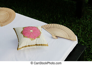 Indian wedding decorations. - Fan and pillows at an Indian...