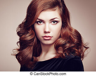 Fashion portrait of elegant woman with magnificent hair...