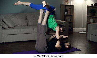 Super Yogi - Two yogis practicing acroyoga flying to super...