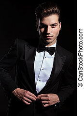 Handsome business man closing his jacket. - Handsome...