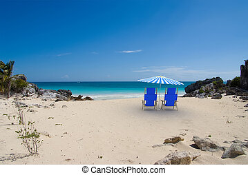 Beach for two - Tropical beach with sunshade and a pair of...